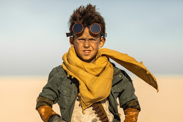 A post apocalyptic boy outdoors in desert